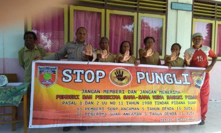 Sosialisasi Saber Pungli, Bhabinkamtibmas Negeri Tananahu di SD Negeri Huse Kecamatan Elpaputih