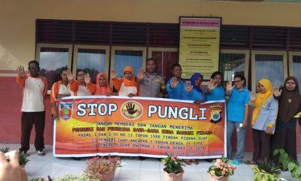 Sosialisasi Saber Pungli, Bhabinkamtibmas Negeri Tamilouw di Sekolah SD 2 Yahalatan Kecamatan Amahai