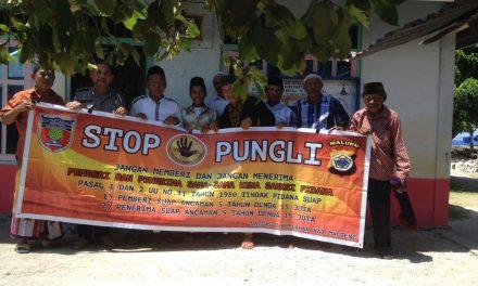 Sosialisasi Saber Pungli, Personil Polsek Seram Utara di Dusun Parigi