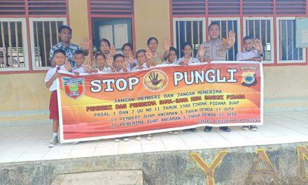 Sosialisasi Saber Pungli, Bhabinkamtibmas Negeri Yamalatu di SD Inpres Yamalatu Kecamatan Telutih