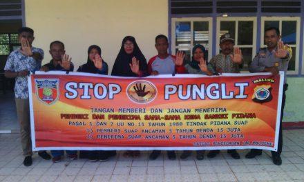 Sosialisasi Saber Pungli, Bhabinkamtias Desa Adm Besi di Sekolah MA LD Desa Adm Besi Kecamatan Seram Utara