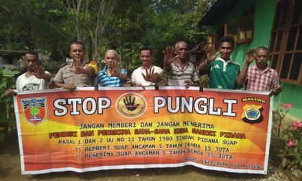Sosialisasi Saber Pungli, Bhabinkamtibmas Desa Sawai di Kantor Balai Pembinaan Umat (BPU) Kecamatan Seram Utara