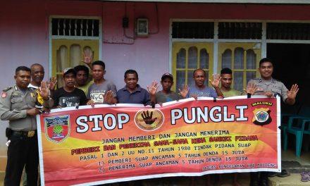 Sosialisasi Saber Pungli, Personil Polsek Seram Utara di Dusun Melinani Desa Manusela