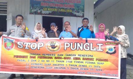 Sosialisasi Saber Pungli, Bhabinkamtibmas ADM Malaku di Sekolah SD Negeri 2 Desa ADM Malaku Kecamatan Seram Utara