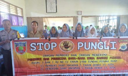 Sosialisasi Saber Pungli, Bhabinkamtibmas ADM Kobi Mukti di Sekolah Madrasah Aliah Al Falah Kecamatan Seram Utara Timur Kobi