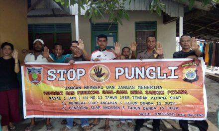 Sosialisasi Saber Pungli, Bhabinkamtibmas Kelurahan Lesane di RT 06 Kelurahan Lesane Kecamtan Kota Masohi