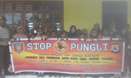 Sosialisasi Saber Pungli, Bhabinkamtibmas Desa Seti di Sekolah SD AL-Hilal Desa Wailoping Kecamatan Seram Utara Timur Seti
