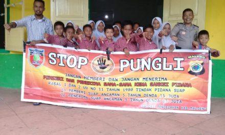 Sosialisasi Saber Pungli, Kanit Binmas Polsek P.P Banda Neira di Sekolah Madrasah Ibti Daya(MI) Al-Hilaal